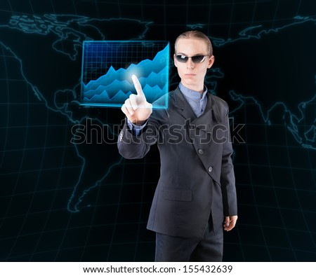 Futuristic businessman analyzing economic data. - stock photo