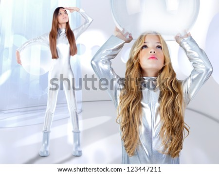 Futuristic children girl and astronaut woman at spacecraft indoor - stock photo