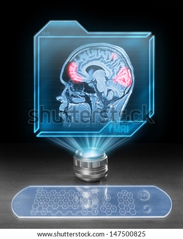 Futuristic computer with scan from functional magnetic resonance as part of research in cognitive neuroscience. - stock photo