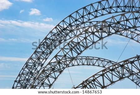 futuristic construction over sky background - stock photo