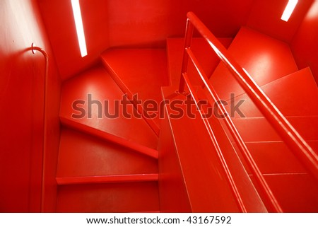 Futuristic designed and illuminated red staircase - stock photo