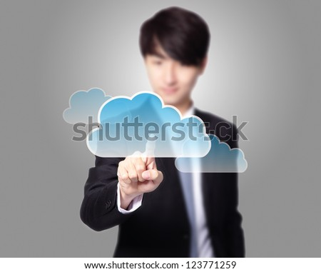 futuristic display: Cloud computing touchscreen interface, business man finger touch cloud with gray background, asian model - stock photo