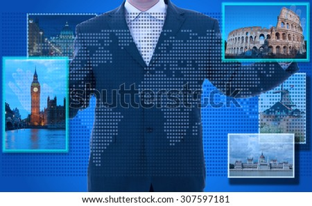 futuristic display:man hand reaching images on the screen - stock photo