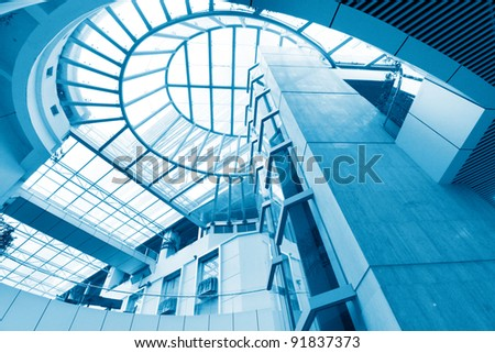 futuristic elevator in the modern building at  china. - stock photo