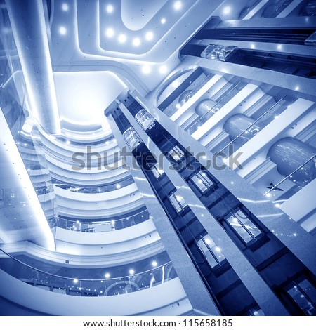 futuristic elevator in the modern building at HK ina. - stock photo