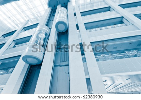 futuristic elevator in the modern building at shanghai china. - stock photo