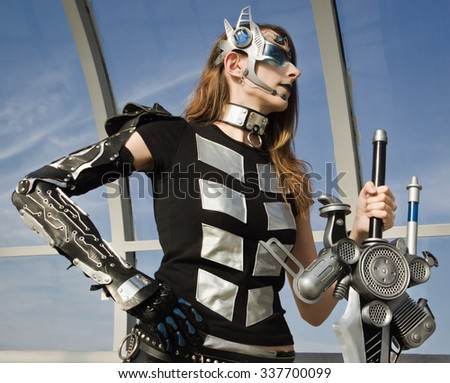 Futuristic girl holding a blade. cosplay character