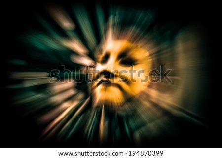 Futuristic golden cyber face with light effects, over black background. Technology and creativity concept. - stock photo