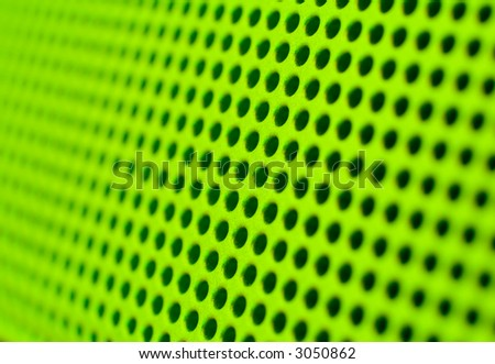 Futuristic green hole grid making an abstract pattern. Shallow DOF. - stock photo