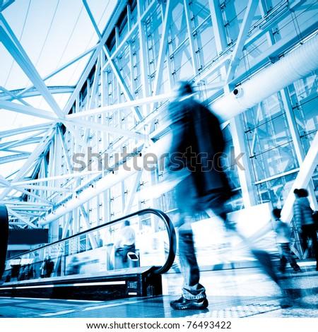 Futuristic guangzhou Airport interior people walking in motion blur - stock photo