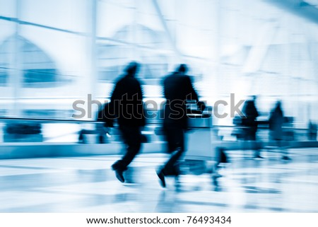 Futuristic guangzhou Airport interior people walking in motion blur - stock photo