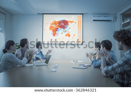 Futuristic interface with the world map against attentive business team applausing after a conference - stock photo