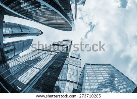 futuristic modern skyscrapers of glass and metal. Focus on buildings. toned photo