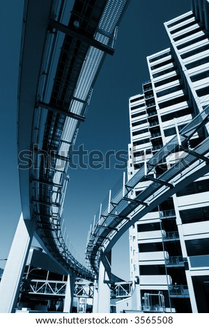 Futuristic monorail going around skyscrapers. Wide angle view. - stock photo
