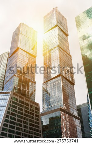 futuristic of skyscrapers in the city. toning image.Focus in center of frame - stock photo