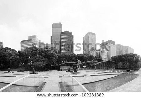 Futuristic photo of Tokyo - panoramic shot of skyline in Shinjuku in black and white, Japan - stock photo