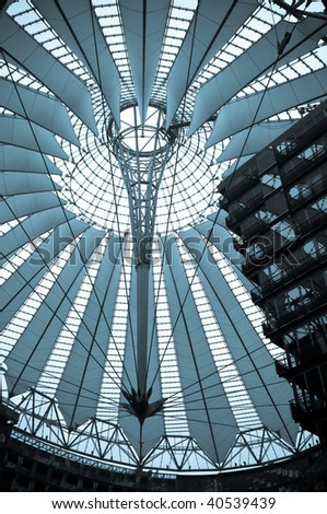 futuristic roof of at the Potsdamer Platz in Berlin, blue tone picture, Germany - stock photo