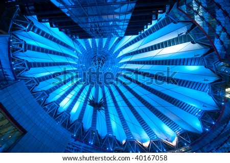 futuristic roof of commercial center at the Potsdamer Platz in Berlin lit by blue light, Germany - stock photo