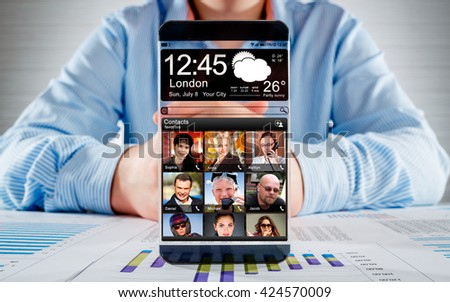 Futuristic Smart phone (phablet) with a transparent display in human hands. Concept actual future innovative ideas and best technologies humanity. - stock photo