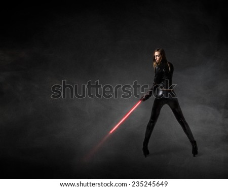 futuristic soldier with red laser sword - stock photo