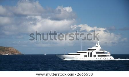 Futuristic styled motor yacht in the caribbean sea - stock photo