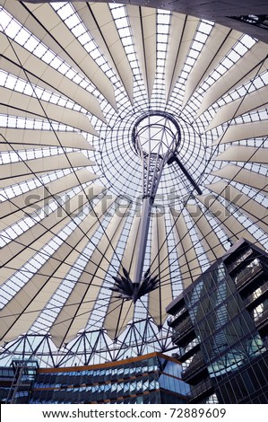 Futuristic umbrella-like tent roof at Sony Center, Potsdamer Platz, Berlin, Germany - stock photo