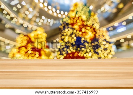 fuzzy abstract christmas tree Light spot background and Wood tabletop - stock photo