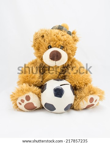 Fuzzy teddy bear with a ceramic ball for saving money. - stock photo
