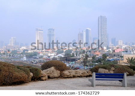 Fuzzy view of foggy Tel Aviv in Israel - stock photo