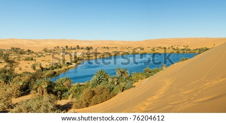 Gaberoun Lake - Idyllic oasis in the Awbari Sand Sea, Sahara Desert, Libya - stock photo