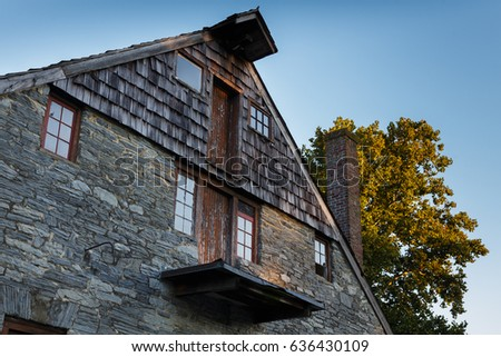 Gable end of an old mill with old doors and windows