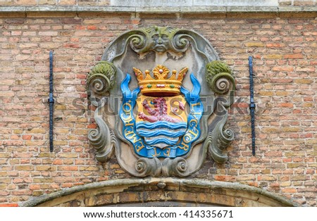Gable stone with coat of arms of the Dutch province of Zeeland in Middelburg, The Netherlands - stock photo