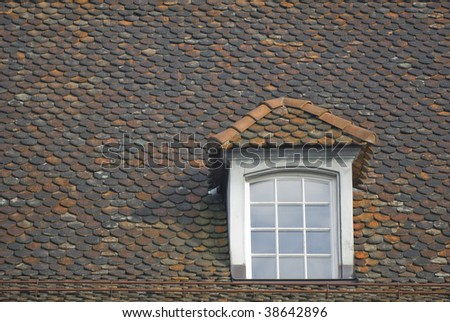 Gabled window with glass panes - stock photo