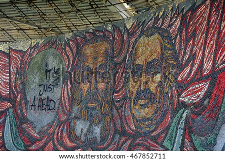 GABROVO, BULGARIA - JULY 20, 2016:  Fragment of mosaic art  of abandoned  communistic monument in Buzludja, Bulgaria.Bulgarian communistic leaders and an empty broken  portrait