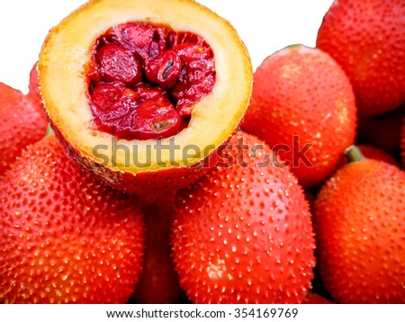 Gac Fruit Or Baby Jackfruit, Cochinchin Gourd, Spiny Bitter Gourd, Sweet Gourd (Momordica cochinchinensis) on  isolated - stock photo