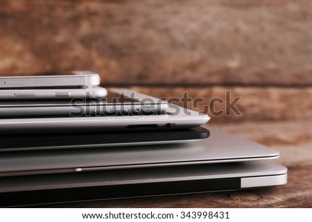 Gadgets on wooden background