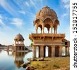 Gadi Sagar (Gadisar) Lake is one of the most important tourist attractions in Jaisalmer, Rajasthan, North India.   	 Artistically carved temples and shrines around The Lake Gadisar Jaisalmer. - stock photo