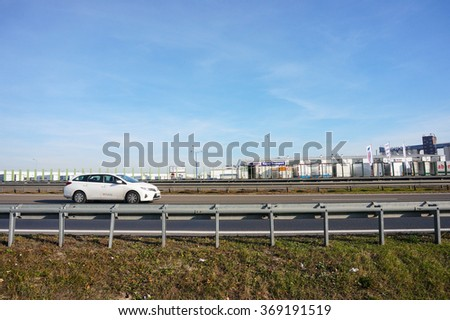 GADKI, POLAND - NOVEMBER 02, 2015: White car driving on a highway with protection barriers