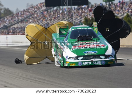 GAINESVILLE, FL - MAR 12: Driver, John Force, slows his Top Fuel race car during the Tire Kingdom NHRA Gatornationals race at the Gainesville Speedway in Gainesville, FL on Mar 12, 2011. - stock photo