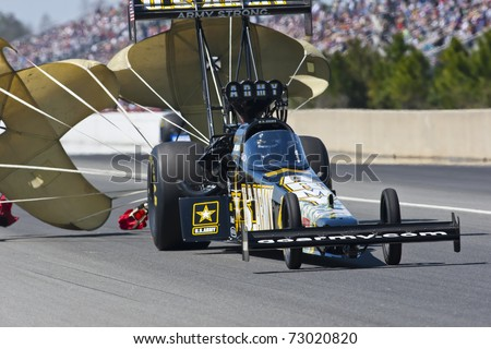 GAINESVILLE, FL - MAR 12: Driver, Tony Schumacher, slows his Top Fuel race car during the Tire Kingdom NHRA Gatornationals race at the Gainesville Speedway in Gainesville, FL on Mar 12, 2011. - stock photo