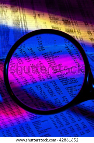 Gains and losses of stock prices under the magnifying glass - stock photo