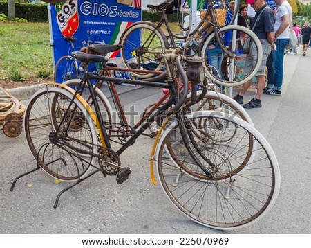 GAIOLE IN CHIANTI, ITALY - 4 OCT. 2014: Vintage bicycles on display at L'Eroica, a  historic cycling event for owners of vintage bicycles who ride through Tuscany on white gravel roads. - stock photo