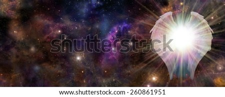 Galactic Guardian - Wide panel of deep space with a pair of Angel Wings on the right hand side and a bright light bursting between depicting an Angelic Guardian - stock photo