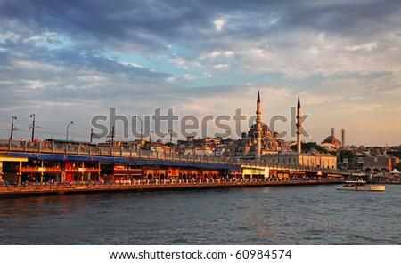 Galata bridge and mosque yeni camii - stock photo