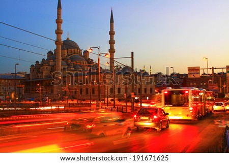 Galata Bridge and Yeni Mosque in Istanbul. Long exposure with traffic movement - stock photo