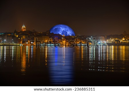 """Galata tower and bridge at night against blue moon""""Elements of this image furnished by NASA """" - stock photo"""