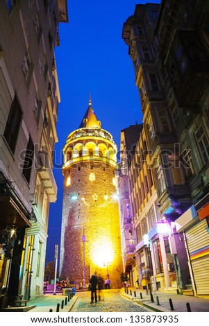 Galata Tower (Christea Turris) in Istanbul, Turkey at night time - stock photo