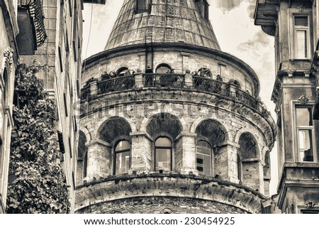 Galata Tower framed by ancient buildings - Istanbul, Turkey. - stock photo