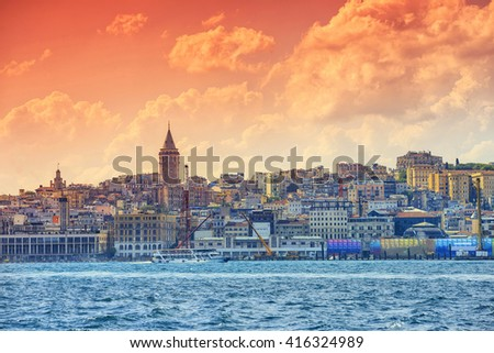 Galata Tower view from the Ferry with red filter applied image - stock photo