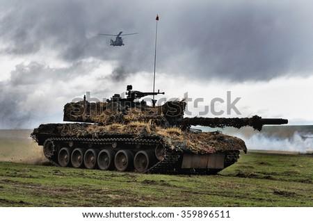 GALATI, ROMANIA - APRIL 22: Romanian tank TR-85M1 in military polygon in the exercise Wind Spring 15 on Galati, Romania, 22 april 2015. - stock photo
